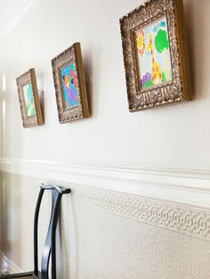 Add a touch of whimsy to any room by hanging your children's artwork in traditional frames. More creative wall ideas: http://www.bhg.com/decorating/home-accessories/wall-art/art-for-walls/?socsrc=bhgpin052912