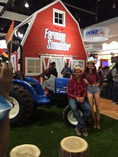 'Farming Simulator': In a logical but kitschy setup promoting the Farming Simulator game, a couple of farmer models posed with a tractor on the show floor.
