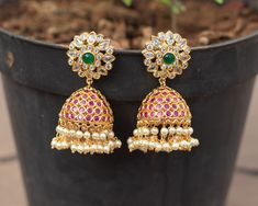 Check out this huge bridal stone jhumkas by the brand South India Jewels. Ear Jewelry, Bridal Jewelry, Gold Jewelry, Nose Ring Designs, Gold Earrings Designs, Jhumka Designs, Imitation Jewelry, Designer Earrings, Indian Jewelry