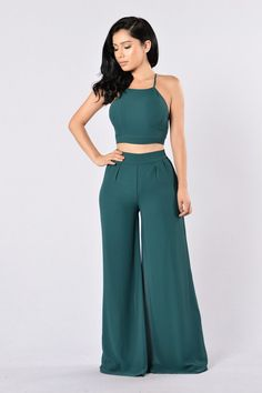 - Available in Hunter Green and Mocha - Woven 2 Piece Set - Lined - 100% Polyester Top - Sleeveless - Cropped - X Back Detail - Tie Back Bottom - Wide Leg - Elastic Waist Band