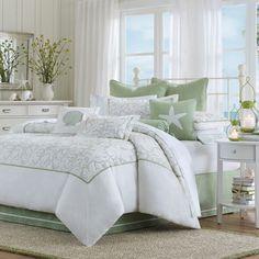 Ocean decor bedroom w/ soft green & white bedding & accessories.