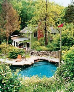 """The house was originally mustard coloured but Christensen wanted it to appear """"like it had been swallowed up by nature"""" so painted it green to match the surrounding trees. The pool was built to resemble a natural pond."""