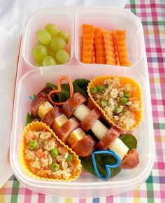 This 'Leftovers on a Stick' bento lunches for kids idea features Thai plum pork sausage and cheese on skewers, Teriyaki fried rice, crinkle cut carrot slices.