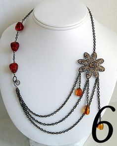 Found at Vintaj's blog. I really like this. I've never seen a necklace quite like this before.