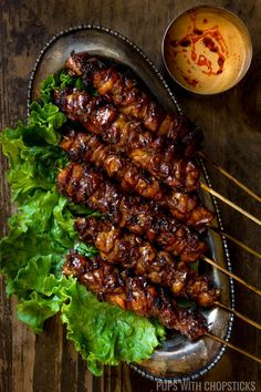Smoky grilled chicken skewers marinaded in ginger, garlic, coconut cream and soy sauce. Then finished with a sweet coconut cream glaze and served with a simple peanut sauce. Big on flavor, super easy to throw together!