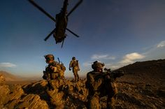 Pararescuemen with the 83rd Expeditionary Rescue Squadron secure the area after being lowered from an HH-60 Pave Hawk during a mission in Afghanistan on Nov. 7, 2012