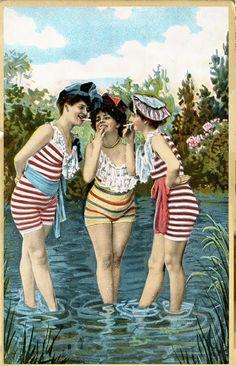 Vintage postcard. Bathing beauties. Three smoking women in striped bathingsuits are standing in the water