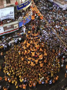 "Indian youths make a human pyramid to break the ""Dahi Handi,"" an earthen pot filled with yoghurt as they celebrate Janamashtami, the birth anniversary of Hindu God Krishna in Mumbai, India, on Monday."