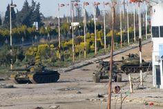 http://www.theatlantic.com/photo/2012/06/syrias-civil-war/100319/