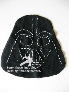 im not a seamstress BUT I do love to cook...how about dart vader cookies? with vanilla frosting piped one there or evern white sprinkles??