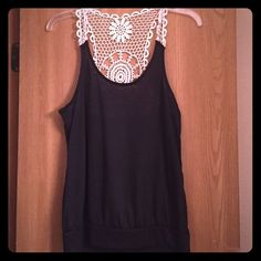Black and lace top This tank is great with a maxi skirt or a cute pair of jeans! This tank has only been worn a couple of times and is still in great condition! Tops Tank Tops