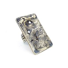 """""""Elements""""  Sterling silver, Brass and 18 carat Gold """"Lost Gold"""" ring, set with Swarovski CZ.  Ring is 1 1/4"""" wide by 1 3/4"""" long  Jewelry Out Loud"""