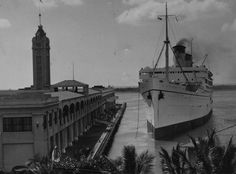 MaritimeQuest - Lurline (1932) Lurline seen alongside the Aloha Tower at Honolulu, Hawaii.