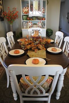 Keep table top natural, paint chairs and base of table white, add fun fabric to chairs.  Craft room - try chalk board paint on table?