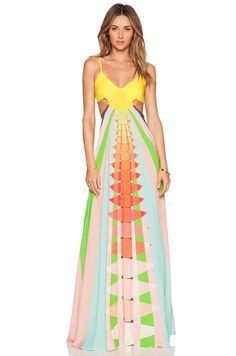 This is a little hippie for me but I love the geometric pattern, colors (for Miami/summer) and cool cutouts.