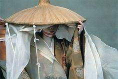 """""""Draped for privacy in the traveling clothes of a 12th-century noblewoman, a geisha walks in Kyoto's annual Festival of the Ages.""""  photo by Jodi Cobb, National Geographic, October 1995"""