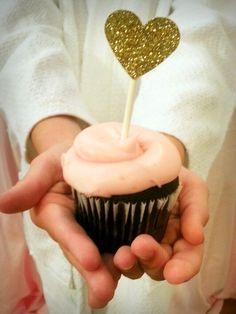 PINK AND GOLD SPA PARTY pink cupcake with glitter heart topper