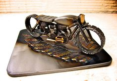 Google Image Result for http://www.motorcycleinsurance.com/wp-content/uploads/2012/04/Josh-Welton-Cafe-Racer-sculpture.png