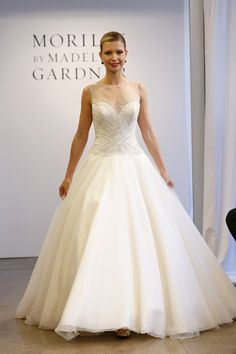 Mori Lee ball gown featuring striking beaded details and trimmed illusion neckline {photo: Dan Lecca}