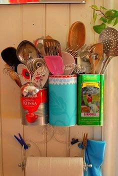 Upcycling Vintage Tins & Cans...or cool idea to spray paint cans and hang on wall in kitchen of camper...could attach a magnetic strip and hang them on that...(?)