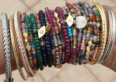 Colorful stack of bracelets perfect for any summer outfit!