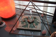 copper pyramid with crystal grid on sacred geometry tile - sacred space