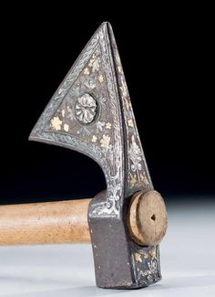 Ottoman war axe. 17th century. Gold and silver inlays in steel.