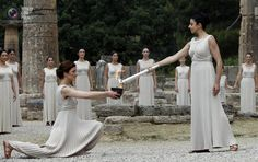 Greek actress Menegaki lights the Olympic flame during the torch lighting ceremony of the London 2012 Olympic Games at the site of ancient Olympia in Greece. JOHN KOLESIDIS/REUTERS