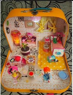 Transform an old suitcase into a doll house