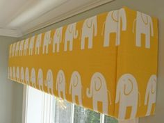 yellow and white elephant nursery Cornices