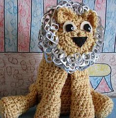 "Cute lion is 9"" tall and has pop tabs for his mane and tip of tail. It takes 75 pop tabs to make this guy. His face is cute out of felt and glued on."