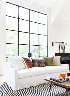 Black framed windows and kilim cushions / pillows in a laid-back, boho cool Californian home. Amber Interiors.