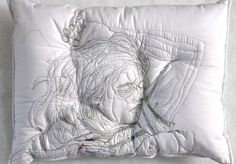 Iranian artist Maryam Ashkanian embroiders individuals deep in sleep onto the surface of her handmade pillows, matching the size of her subjects to the area one would physically occupy if they took a nap on her work. The stitched sleepers lay sprawled in different configurations on the white backgro
