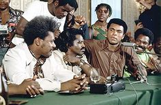 Muhammad Ali holds a press conference along with Don King, James Brown and Lloyd Price