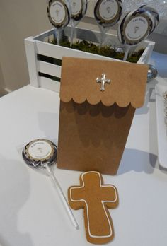 Communion Giveaways - gift bag, personalised lollipop by Kesia and cross cookies by Yvette Crawley.