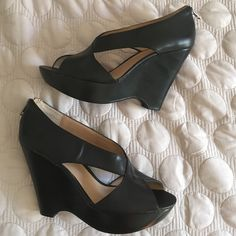 NWT NINE WEST black cross front peep toe wedges New never worn. Nine West. Size 9.5 black wedges with cross front peep toe. Zip back closure Nine West Shoes Wedges