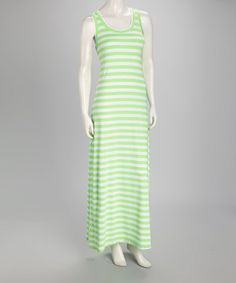 With a striped design across this dress, it's sure to be a trendy and sumptuous staple. A hint of stretch and maxi silhouette create a favorite frock.