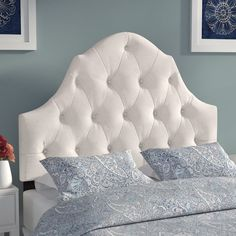 Give your master suite or guest room a pop of glamour with this chic tufted headboard, perfect paired with plush pillows and a cozy comforter.