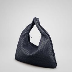 """http://www.bvbags.net/Its concave armhole and flattened, minimalist body are balanced by a substantial handle, making it both roomy, comfortable as well as distinctive. Dimensions:20.1"""" W x 19.7"""" H x 2"""" D"""