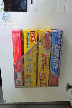 Kitchen wrap holder: Attach a magazine/file holder to the back of a cabinet door and use it to store all your kitchen wraps.