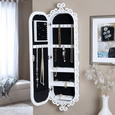 I like this  Belham Dwelling Wall Scroll Locking Jewellery Armoire - Excessive Gloss White - sixteen.5W x 50H in.   www.hayneedle.com