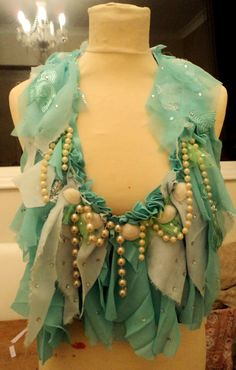 *This listing is for custom orders only* These are examples of boho mermaid tops, which you can have made just for you! I can make your top in any size and colours that you like,. I use only recycled garments and fabrics to ensure you have an eco-friendly and one-off piece. All tops come adorned with seashells and pearls. Please message me before purchasing :) If you have any questions, dont hesistate to ask! Meg