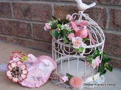 pink bird and birdcage