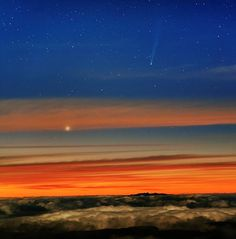 "Comet ISON and Mercury in the dawn over the Teide Observatory in the Canary Islands. Taken 2013-11-21. (Credit: Juan Carlos Casado) The comet was barely visible to the unaided eye. This image was taken with a camera with a small photographic lens. Mona Evans, ""Comets"" http://www.bellaonline.com/articles/art33712.asp"