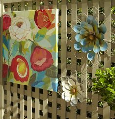 Bring whimsy to an outdoor space with cool metal Wall Flowers