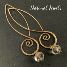 Earrings totally handcrafted from 14K Goldfilled wire.    An elegant line of gold that ends in a spiral, simple and outstanding. Hanging from the spir