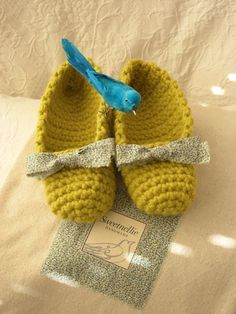 These cozy slippers are crocheted from a very thick, chartreuse yarn, which makes them so comfortable for pattering about your nest. The fiber is a