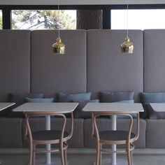 | P | Grey Banquette Seating, natural wood Thonet Bentwood Chairs, brass fixtures - La Plage Casadelmar Hotel