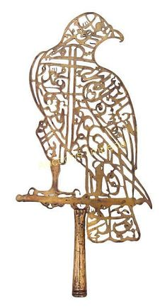 A PERSIAN 'ALIM STANDARD HEAD - by Auctions Imperial LLC