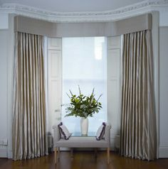 Swags & tails in a bay window with interlined curtains in Nepal Silk Antique Copper. Description from pretavivre.com. I searched for this on bing.com/images